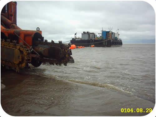Pipeline Trenching: Subtrench One with Pontoon Barge. Click to go back.