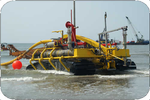 Subtrench Two Trenching Machine: Driving up the Beach. Click to go back.