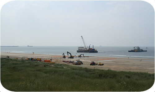 Subtrench Two Trenching Machine: Setting Up Q7 Beach Crossing with Trenching and Cable Laying Barges. Click to go back.